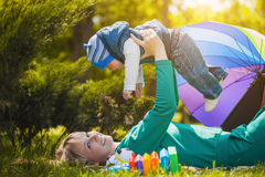 Happy mother and baby on the meadow Royalty Free Stock Images