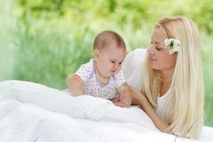 Happy mother and baby on natural background Stock Photo