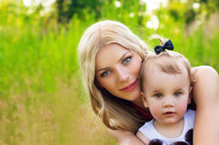 Happy mother and baby on nature background Stock Photography
