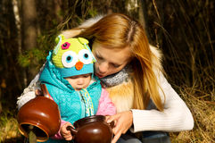 Happy mother with baby on nature in the forest rest Royalty Free Stock Photos