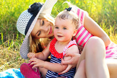 Happy mother with a baby in nature Royalty Free Stock Photography