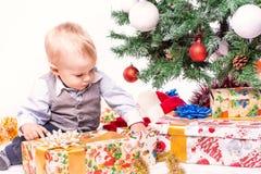 Happy mother and baby near Christmas tree Royalty Free Stock Photo
