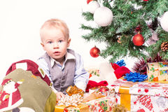 Happy mother and baby near Christmas tree Stock Image