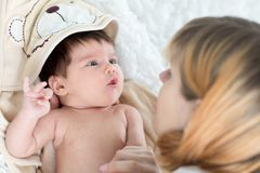 Happy mother and baby newborn looking each at other Royalty Free Stock Photos