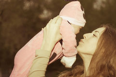 Happy mother with baby at outdoor Stock Image