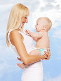 Happy mother with baby outdoors Royalty Free Stock Photo
