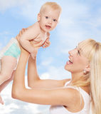 Happy mother with baby outdoors Stock Photo