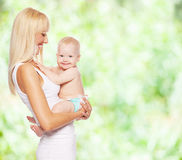 Happy mother with baby outdoors Royalty Free Stock Photography