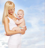 Happy mother with baby outdoors Stock Photos