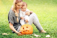 Happy mother and baby outdoors Royalty Free Stock Images