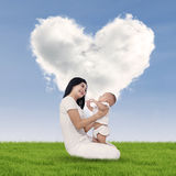 Happy mother and baby outdoors Stock Photography