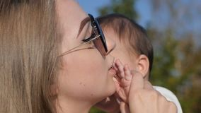 Happy mother and baby outdoors walking in summer day stock footage