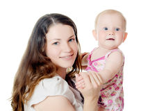 Happy mother with baby over white. The happy mother with baby over white Royalty Free Stock Photography