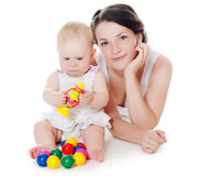 Happy mother with baby over white. The happy mother with baby over white Stock Images