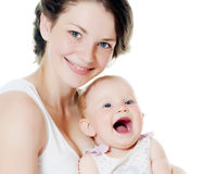 Happy mother with baby over white. The happy mother with baby over white Royalty Free Stock Images