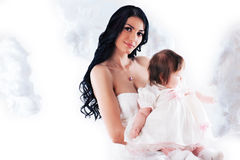 Happy mother with baby over white. Picture of happy mother with baby over white Royalty Free Stock Photo