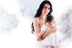 Happy mother with baby over white Stock Photo