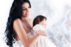 Happy mother with baby over white. Picture of happy mother with baby over white Stock Photography