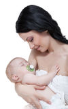 Happy mother with baby over white. Picture of happy mother with baby over white Stock Photo