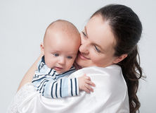 Happy mother with baby over white Royalty Free Stock Photos