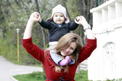 Happy mother and baby in park Stock Photos