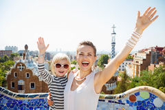 Happy mother and baby at Park Guell rejoicing, Barcelona Royalty Free Stock Photography