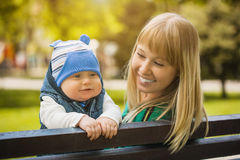 Happy mother and baby in the park Stock Image