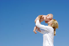 Happy mother and baby playing Royalty Free Stock Images