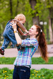 Happy mother with the baby playing Royalty Free Stock Images