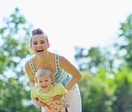 Happy mother and baby playing outside Royalty Free Stock Photo