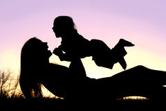 Happy Mother and Baby Playing Outside Silhouette Royalty Free Stock Image