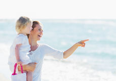 Happy mother with baby pointing on copy space Royalty Free Stock Image