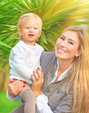 Happy mother with baby Stock Photos