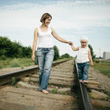 Happy mother with baby on railroad Stock Photography