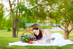 Happy  mother and baby resting in summer park Stock Photography