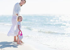 Happy mother and baby on sea shore Stock Photography