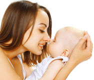 Happy mother and baby. Happy mother and a sleeping baby Royalty Free Stock Image