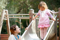 Mother with baby  on slide Royalty Free Stock Photography