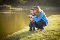 Happy Mother and Baby Son Looking Out At Lake Royalty Free Stock Images