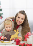 Happy mother and baby spending christmas time together Stock Photos