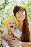 Happy mother with baby  in spring Royalty Free Stock Image