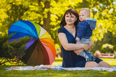 Happy mother and baby in the summer park Stock Photography