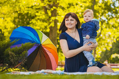 Happy mother and baby in the summer park Royalty Free Stock Photos