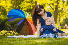 Happy mother and baby in the summer park Stock Photo