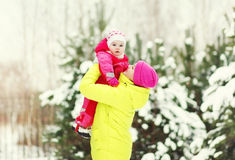 Happy mother with baby walking in winter day Royalty Free Stock Images