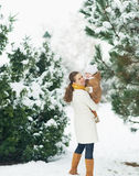 Happy mother and baby walking in winter park Royalty Free Stock Photos