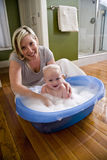 Happy mother bathing her cute baby Royalty Free Stock Image