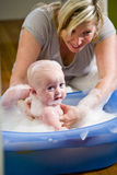 Happy mother bathing her cute baby Royalty Free Stock Photo
