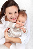 Happy mother and beautiful baby girl Royalty Free Stock Photos