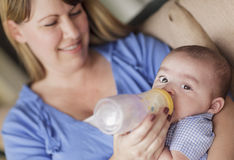 Happy Mother Bottle Feading Her Son Royalty Free Stock Photo